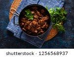 jug of goulash beef stew with... | Shutterstock . vector #1256568937