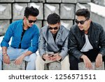 group of three casual young... | Shutterstock . vector #1256571511