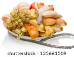 Silver metal snake and fruit on a plate isolated on white background - stock photo