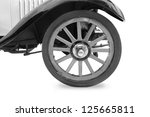 Vintage tire and wood rim  of old classic car - stock photo