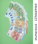 euro banknotes and coins  eur   ... | Shutterstock . vector #1256669464