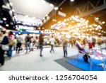Small photo of Abstract blurred defocused tradeshow event exhibition, business convention show, job fair, technology expo. Organization company trade fair event. Marketing advertisement concept.