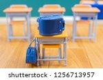 school bags and desks and... | Shutterstock . vector #1256713957