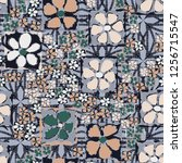 seamless camouflage pattern.... | Shutterstock .eps vector #1256715547