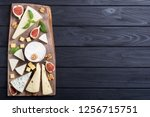 cheeseboard with cheese brie  ... | Shutterstock . vector #1256715751