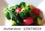 best vagan food on white plate...   Shutterstock . vector #1256738224