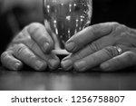elderly man's hands holding... | Shutterstock . vector #1256758807