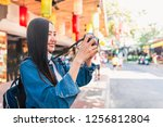 happy young asian woman... | Shutterstock . vector #1256812804