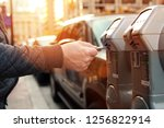 man is paying his parking using ... | Shutterstock . vector #1256822914