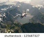 Aircraft Flies Over A Mountain...
