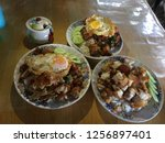 rice and stir fried crispy pork ... | Shutterstock . vector #1256897401