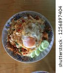 rice and stir fried crispy pork ... | Shutterstock . vector #1256897404