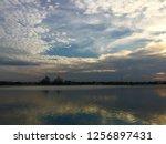 amazing tropical      sunset ... | Shutterstock . vector #1256897431