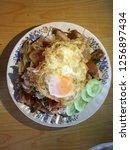 rice and stir fried crispy pork ... | Shutterstock . vector #1256897434