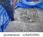 workers are breaking the tile... | Shutterstock . vector #1256935981