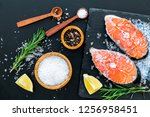 cooking salmon steak from raw... | Shutterstock . vector #1256958451
