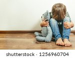 sad depressed boy with teddy... | Shutterstock . vector #1256960704