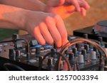 hand of dj controlling... | Shutterstock . vector #1257003394