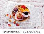 pancakes breakfast in bed... | Shutterstock . vector #1257004711