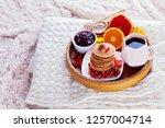pancakes breakfast in bed... | Shutterstock . vector #1257004714