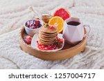 pancakes breakfast in bed... | Shutterstock . vector #1257004717