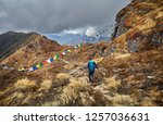 man with backpack on the trail... | Shutterstock . vector #1257036631