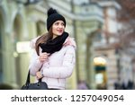 young woman with her bag on... | Shutterstock . vector #1257049054