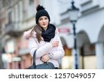 young woman with her bag on... | Shutterstock . vector #1257049057
