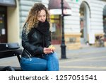 young woman opening a gift box... | Shutterstock . vector #1257051541