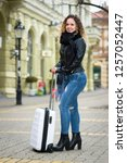 young tourist woman with her... | Shutterstock . vector #1257052447