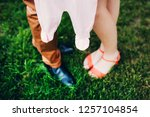 young parents hold baby romper. ... | Shutterstock . vector #1257104854