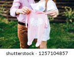 young parents hold baby romper. ... | Shutterstock . vector #1257104857