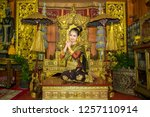 lao girl dressed in traditional ... | Shutterstock . vector #1257110914