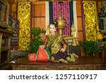 lao girl dressed in traditional ... | Shutterstock . vector #1257110917