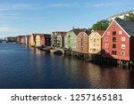 store houses at nidelva river... | Shutterstock . vector #1257165181
