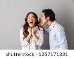 excited asian couple standing... | Shutterstock . vector #1257171331
