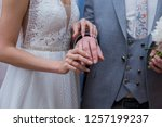 bride dresses the bridegroom a... | Shutterstock . vector #1257199237