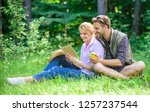 romantic date at green meadow.... | Shutterstock . vector #1257237544