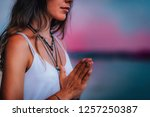 young woman meditating with her ... | Shutterstock . vector #1257250387