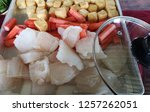 close up fresh fish fillet and... | Shutterstock . vector #1257262051