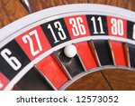Stock photo close up of ball on roulette wheel in number thirteen 12573052
