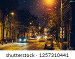 winter illuminated city street... | Shutterstock . vector #1257310441