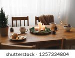 cozy evening tea party by... | Shutterstock . vector #1257334804
