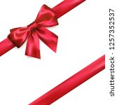 shiny red silk bow and ribbon... | Shutterstock .eps vector #1257352537