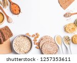 Small photo of Different types of high carbohydrate food. Flour, bread, dry pasta and lentils and other ingredients on the white background.