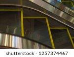 escalator in shopping mall.... | Shutterstock . vector #1257374467
