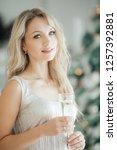 happy blonde women in christmas ... | Shutterstock . vector #1257392881
