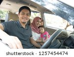 young muslim family   transport ... | Shutterstock . vector #1257454474