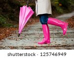 Woman With Umbrella Wearing...