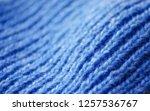 the texture of a knitted woolen ... | Shutterstock . vector #1257536767